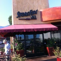 Photo taken at Stonefire Grill by Jed C. on 7/23/2012
