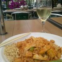 Photo taken at Pi-Tom's Thai Cuisine by Corrie C. on 5/27/2012