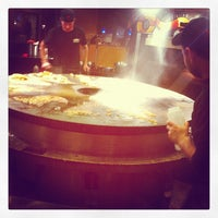 Photo taken at HuHot Mongolian Grill by Cory C. on 12/3/2011