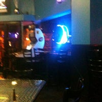Photo taken at The Blue Bull Bar & Grill by David V. on 2/4/2011