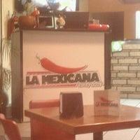 Photo taken at La Mexicana Tacos Y Cortes by Nancy G. on 11/24/2011