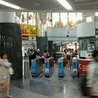 Photo taken at Orchard MRT Station (NS22) by Tania A. on 6/15/2012