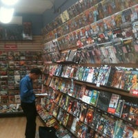 Photo taken at Midtown Comics by Erdem T. on 7/18/2012