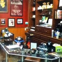 Photo taken at Bo's Cigar Lounge by Ilya S. on 1/13/2011