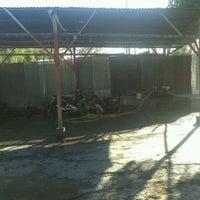 Photo taken at Cuci Motor Dharma loka by Mawar M. on 10/22/2011