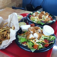 Photo taken at PDQ Tenders Salads & Sandwiches by Emery J. on 8/23/2012