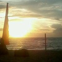 Photo taken at Pantai Senggigi by Chabi Batur R. on 2/7/2012