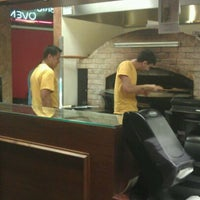 Photo taken at Spasso's Pizza by James C. on 12/19/2011