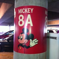 Photo taken at Mickey & Friends Parking Structure by Veronica M. on 3/9/2012