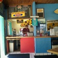 Photo taken at Kono's Surf Club Cafe by Di R. on 10/8/2011