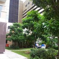 Photo taken at Thai CC residence garden by Wisit B. on 7/3/2012