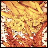 Photo taken at Red Robin Gourmet Burgers by Suzette F. on 6/22/2012