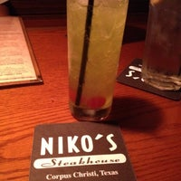 Photo taken at Niko's Steakhouse by Melissa G. on 4/3/2012