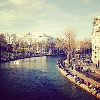 Photo taken at Canal Saint-Martin by Ike E. on 4/2/2012