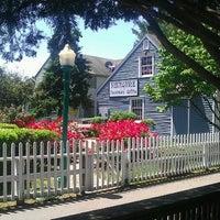 Photo taken at Olde Mystic Village by Angela G. on 6/1/2012