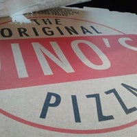 Photo taken at The Original Gino's Pizza #5 by Naz T. on 12/26/2011