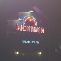 Photo taken at Montana Mikes Steakhouse by Chris D. on 12/23/2011