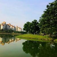 Photo taken at Taman Tasik Ampang Hilir by Edward F. on 7/14/2012