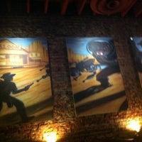 Photo taken at Atomic Cowboy by Dustin C. on 3/20/2012
