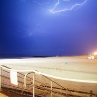 Photo taken at The Beach Bar by Mike G. on 7/29/2012