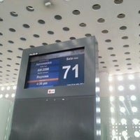 Photo taken at Sala/Gate 71 by Helier H. on 7/23/2012