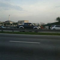 Photo taken at Lebuhraya Persekutuan (Federal Highway) by Mimi R. on 11/30/2011