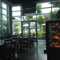 Photo taken at Mozu Cafè by Arlene C. on 5/1/2012