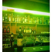 Photo taken at Oltre Il Mare Libreria Wine Bar by Federico on 8/28/2011