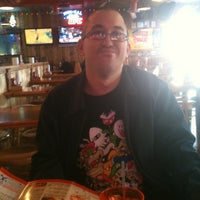 Photo taken at Hooters by Rebecca U. on 2/28/2012
