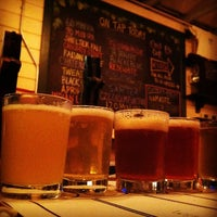 Photo taken at Dogfish Head Brewings & Eats by Michael M. on 6/12/2012