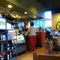 Photo taken at Starbucks by Teddy B. on 5/22/2012