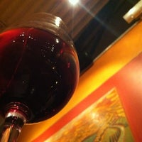 Photo taken at Orzo Kitchen & Wine Bar by Derick W. on 1/7/2012