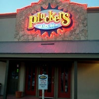 Photo taken at Pluckers Wing Bar by Steven N. on 5/21/2012