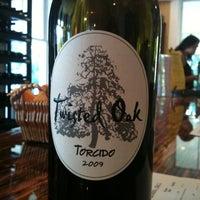Photo taken at Twisted Oak Winery Murphys Tasting Room by Kristi C. on 10/23/2011