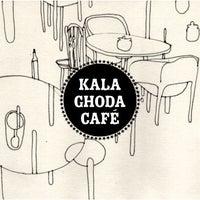 Photo taken at Kala Ghoda Café by Vivek V. on 2/15/2012