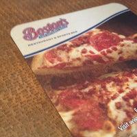 Photo taken at Boston's Restaurant & Sports Bar by Angel on 5/4/2012