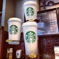 Photo taken at Starbucks by Adrien V. on 4/12/2012