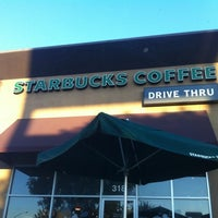 Photo taken at Starbucks by Sam H. on 8/10/2011