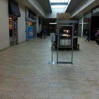 Photo taken at Gerrard Square by Joey W. on 2/26/2012
