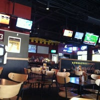 Photo taken at Buffalo Wild Wings by Travis on 8/25/2011