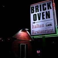 Photo taken at Brick Oven on 35th by Ricardo G. on 2/20/2012