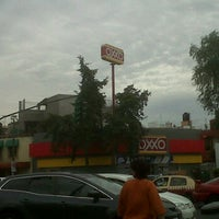 Photo taken at Oxxo Tepetlapa by Dy P. on 2/18/2012