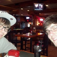 Photo taken at Smokey Bones Bar & Fire Grill by Lisa D. on 5/6/2012