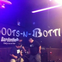 Photo taken at Boots N Bottles by Raymond M. on 2/19/2012