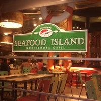 Photo taken at Blackbeard's Seafood Island by Xavier D. on 7/13/2012