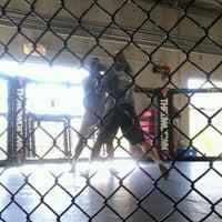 Photo taken at Throwdown Training Center Las Vegas by Nina T. on 9/1/2011