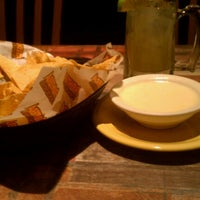 Photo taken at Frontera Mex-Mex Grill by Carmen S. on 8/25/2012