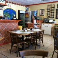 Photo taken at Azucar Restaurant & Bakery by Amp P. on 8/25/2011