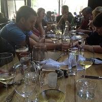 Photo taken at Purple Café & Wine Bar by Katie K. on 7/7/2012
