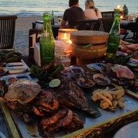 Photo taken at Jimbaran Bay Seafood by Des.L on 9/13/2012